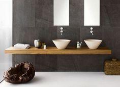 Dark tiled wall, white floor bathroom