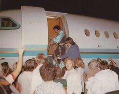 Boarding a plane after his concert in Asheville on July 24, 1975 on his way home to Memphis at the end of the tour (Elvis didn't start using the Lisa Marie until November 1975)