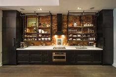 contemporary kitchen industrial style design black cabinetry white countertop exposed brick wall open shelves