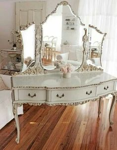 Love this white lacquered antique vanity