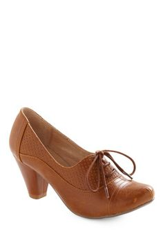 $59.99 - ModCloth - In these delightful, vintage-inspired heels, your presence and fashionable panache will always make itself known. These caramel brown pumps offer seriously adorable style with their rounded toe, walkable wedge heel, sweet lace-up silhouette, and panel of perforation. Pair with scrunched ankle socks, an accordion-pleated skirt, your favorite cashmere cardi, and tortoiseshell specs for a ravishingly retro look that will leave onlookers speechless.