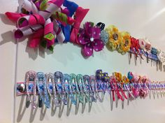 Hair clip storage. Thumb tacks and pretty ribbon on the back of their wardrobe door or right on wall