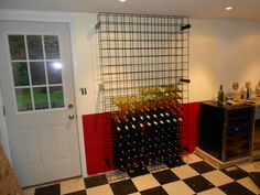 """A truly """"think like me"""" way of using goat fence panels as a wine rack..."""