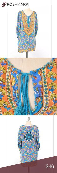 Tolani vibrant boho silk hippie tunic Super sweet boho blouse/tunic from Tolani. Bright teal, with yellow and orange boho style psychedelic print. Oversized stitching at neckline with a keyhole. 100% washed silk; soft and breezy. 3/4 length sleeves. Size M.  **side seams have been repaired at the hems - professionally done and on the inside of the garment, not noticeable when worn. Anthropologie Tops Tunics