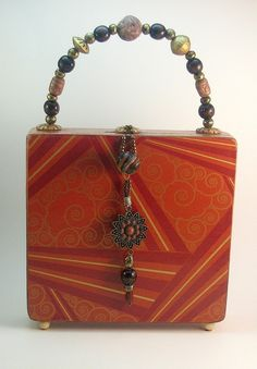 Cigar Box Purse - Found at Good will store for $3.00, similar to this one.  Thought it was a good idea since I collect evening bag/purses and boxes......