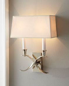 """Chrislyn"" Sconce $275    ""Chrislyn"" Sconce    Modern two-light wall sconce gleams in polished nickel finish. Imported.  Handcrafted of brass with a paper shade.  Uses two 60-watt bulbs.  10""W x 5""D x 12.5""T."