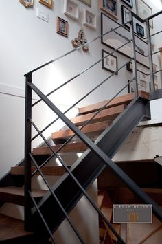 Industrial Loft Stair Hall -  Architect Ryan Duffey removed the existing narrow spiral staircase and created a stair hall allowing in more natural light.  Reclaimed wood was used for the treads but the industrial feel was maintained with the iron railing.  www.jryanduffey.com