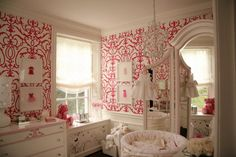 I wouldn't have ever picked red and white for a nursery....but how cute is this?