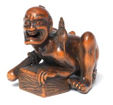 A wood okimono netsuke of a ratcatcher Meiji era (1868-1912), late 19th century