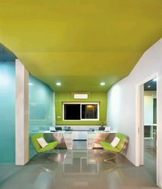 glass partition, green and white couch with a wavy green ceiling