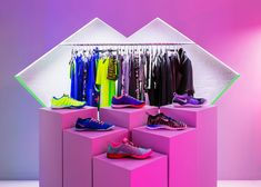 Robert Storey Studio uses lurid colours to light Nike pop-up shop