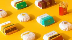 """McDonald's launches playful redesign of its packaging In a bid to simplify and modernise its packaging, Pearlfisher opted to highlight the fast food chain's well-known menu using graphic illustrations McDonald's has teamed up with independent design agency Pearlfisher to redesign the brand's global packaging system. The focus is on a bold graphics system that aims to """"bring a sense of joy and ease"""", and uses vector Mcdonalds, Coca Cola, Fast Food Franchise, American Fast Food, Fast Food Chains, Simple Illustration, Graphic Illustrations, Design System, Menu Items"""
