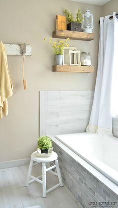 You would be hardpressed to not feel totally relaxed in this elegant farmhouse bathroom styled by Sarah of @lilvintagenest. Here, she pairs a warm coat of Smokestack with rustic wooden floating shelves and gorgeous subway tile.
