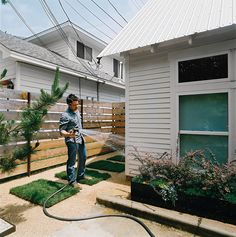 Dollahite tackled landscaping last, installing climate-sensitive plants in metal planters he designed himself.