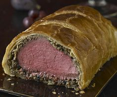 If Britain has a holiday culinary showstopper; it's got to be beef Wellington. This triumphant marriage of beef tenderloin, sautéed mushrooms, and rich chicken liver pâté (or truffles and pâté de foie gras, if you want to break the bank), rolled first in tender crêpes and then in buttery puff pastry, makes a grand centerpiece.