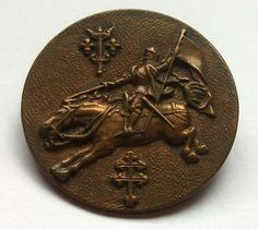 A badge portraying Joan of Arc and her heraldic coat of arms (above) and the cross of Lorraine (below). (Seeing Symbols)