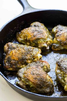 EASY 1-Pot Chicken thighs with spicy chermoula sauce, a North African parsley and cilantro pesto.