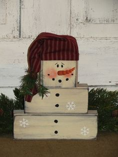 I have designedthis wood block set to be used the entire Christmas and winter holiday season. I have scattered a few snowflakes on the snowman and added a homespun hat tied with a rusty bell and pine. Will make a nice shelf sitter for your home décor. Measures approx. 8 x 10high