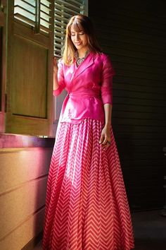 Pink organza wrap around top with a silk inner and a printed lehenga. NOTE: The maximum length of the lehenga will be and any additional length based on the size chart will be with an added border of the same print. Lehenga Designs, Kurta Designs, Kurti Designs Party Wear, Blouse Designs, Dress Designs, Indian Fashion Dresses, Indian Gowns Dresses, Dress Indian Style, Indian Designer Outfits
