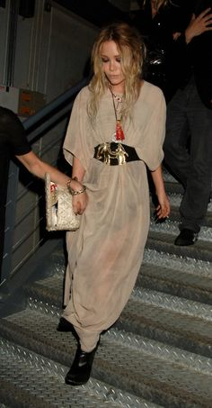MK wins with that taupe/beige dress held together with a massive belt adorned with an elephant.  I also think it's chic to see a waif being escorted down a flight of stairs.