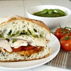 Big tomato sandwich ~ PACKED FULL of amazing toppings and slathered with pesto and a homemade vinaigrette!