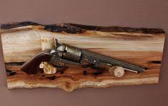 Pistol Display Rack- A81 Aspen wood with pine rests .  Fits Older model revolver. Colt Navy shown Wall mount.