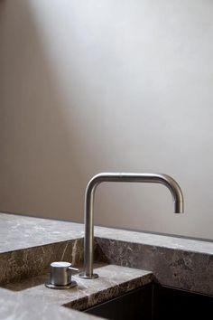 stone benchtop. recessed basin sink. mixer. minimal detail.