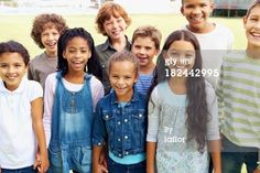 Stock Photo : Portrait of happy children smiling together in park