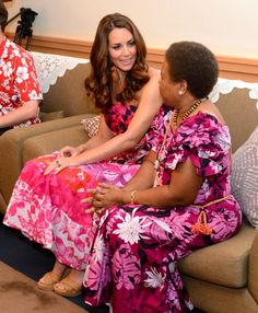 Day 6 Diamond Jubilee Tour, Solomon Island: Kate Middleton wearing a new pink dress made up of local Solomon fabric that she only tried on an hour ago. - 16 Sept 2012