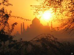 Catch the sunrise at Taj Mahal.