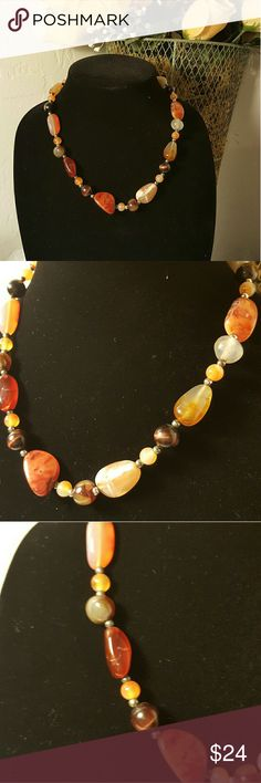 Beautiful stone necklace This is a beautiful 19 inch Stone necklace with small silver beads in between. Claw hook closure with 2 inch chain adjustable length. See pics. The stones are Amber and Brown and  Cream colored. Jewelry Necklaces