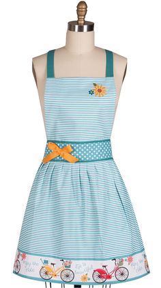 This charming, pretty and cute Enjoy The Ride kitchen women's Apron features a gathered blue and white horizontal thin striped skirt; and a 4-inch decorative skirt border. The border is accented with                                                                                                                                                                                  More