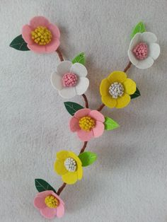 Create a spectacular flower wall mural with this beautiful flower design.  Make them as big as your like to cover more surface area.  These flowers will make any baby girl's nursery room or little girl's room look lovely.     Materials felt in different colors soft wire needle and thread fabric glue scissors