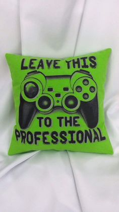 """There's one person for this job... and it's you! This video game bedding has a console controller with the words, """"Leave this to the professional"""" in dark gray on a lime green background. A great litt"""