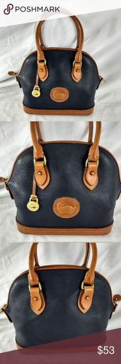 VTG DOONEY & BOURKE NAVY / TAN HANDBAG VINTAGE DOONEY AND BOURKE.  Really nice condition.  The only wear I see is that I am not sure if the bottom of the inside of the bag is original or if it might be missing a lining.  Note last photo, the bottom is clean but it's just plain, like a piece of leather or a type of board.  In all other respects this bag looks super nice.  Some minor wear on straps and bottom.  Very heavily made bag, excellent quality.  MEASURES:  10 X 4.5 X 9.5   office right…