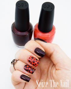 Plum and orange polka dot nails