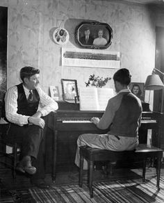 Mining Town/ Pa. Coal miner Mike Kalenak watching his son George, 14, play the piano at his modest home. | Photographer: Alfred Eisenstaedt | Date taken: April 1943 | Location: Nanty Glo, PA, US | LIFE Archive - Hosted by Google