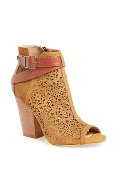 Cute for spring and summer! Adore the starry perforation on this Vince Camuto bottie.