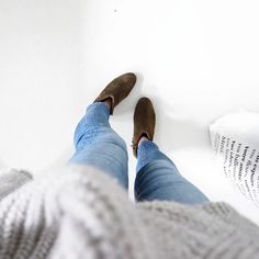 love the boots and light wash jeans with what looks like a casual, cute sweater