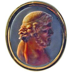Antique Agate and 18K Gold Cameo Ring. Exquisitely carved realistic portrait of a man in agate, set in an 18K gold ring mount of the period. The quality of the carving brings to life the person depicted. He is real, he lived. We see him now as he was, wavy hair, curly beard and furrowed brow. An amazing piece of art. Great Britain, circa 1760
