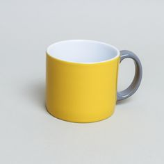 Serax International Jansen And Company Yellow My Mug : Colourblock ceramic mug in yellow with a grey handle, designed by Anouk Jansen of Jansen & Company. A classic, simple shape, My Mug is also available in blue or jade green - mix and match for a contemporary look. Gift boxed. Other co-ordinating products are also available.