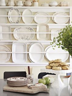 Make an artful asset of hard-to-store goods; this custom rack displays the oversize dishes.