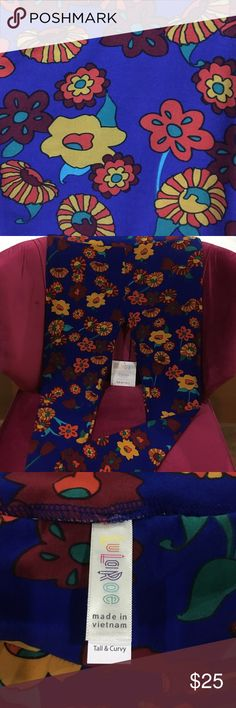 LuLaRoe TC Leggings BNWT! Never worn, never tried on. Blue background with maroon, mustard yellow, orange, and green. Very pretty in person and perfect for spring! This is a tall and curvy size, please see fourth pic for LLR size guide. No trades, REASONABLE offers accepted for consideration. Thanks❣️ LuLaRoe Pants Leggings