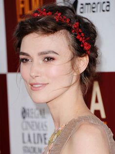 Keira Knightley floral crown with a wispy updo hairstyle | allure.com