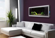 """An """"in the wall"""" aquarium blends well with the overall decor. A piece of """"Living Art"""" if you will..."""