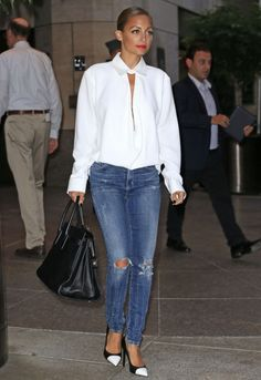 Nicole Richie in simple but daring bright white plunge neck blouse, jeans, black purse and cap toe pumps. #loveherlook