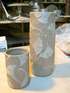 "meesh's pottery: ""start with slip resist then add carved leaves""  I do Gingko leaves too, very similar style."