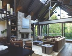 """GREAT ROOM: Steel rods overhead are a modern reinterpretation of a timber frame structure. Wood window frames are so delicate they mimic metal in thinness, architect Brad Lamoureux says. """"We wanted it to feel like tracery you'd find in a gothic cathedral."""""""