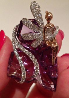 This would be even more fantastic if Tink was sitting on an emerald. Amethyst, gold, and diamond Tinkerbell pendant by Yael Designs. Via Diamonds in the Library.