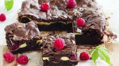 Stud brownies with raspberries, nuts and chunks of white chocolate for tea time delight, from the Great British Bake Off cook books